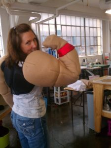 Laura w/ muscled mascot arms